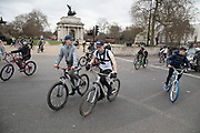 Thousands of cyclists from Bike Life on a mass ride-through block the street and wheelie their cycles around Hyde Park Corner in London, United Kingdom. This was like a flash mob event, where suddenly the whole street was filled with bicycles that took over the streets.