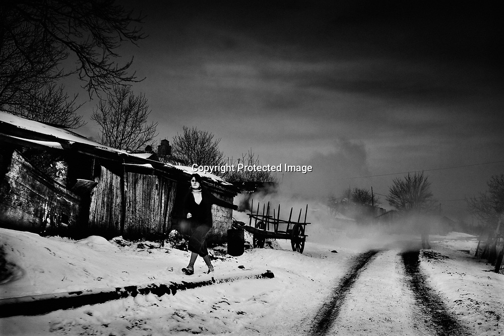 Displaced people in Georgia - Future. A girl walks up a snow covered path, Georgia, Tuesday, Jan. 30, 2007<br /> <br /> The RDP's from Abkhazia have been living under these conditions in 15 years now and nothing looks to change for the better.