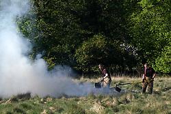 Firefighters extinguish a wild fire, 06 May 2020<br /> <br /> Pictured: Firefighters extinguish a wild fire in Mid Calder, Livingston<br /> <br /> <br /> Alex Todd | Edinburgh Elite Media