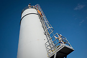 Rescuers practice high angle structure rescue and evacuation during training at a factory tower.