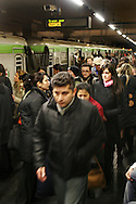 Commuters on overcrowded Milan underground trains.