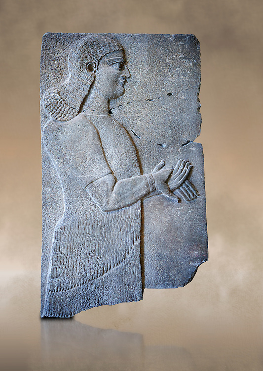 Stone relief sculptured panel of a Royal servant. From the palace of Teglat-phalasar II, Nimrud, third quarter of the 8th century BC. inv 19852  Louvre Museum , Paris .<br /> <br /> If you prefer to buy from our ALAMY PHOTO LIBRARY  Collection visit : https://www.alamy.com/portfolio/paul-williams-funkystock/ancient-assyria-antiquities.html  Refine search by adding background colour, place, subject, museum etc into the LOWER SEARCH WITHIN GALLERY box to <br /> <br /> Visit our ANCIENT WORLD PHOTO COLLECTIONS for more photos to download or buy as wall art prints https://funkystock.photoshelter.com/gallery-collection/Ancient-World-Art-Antiquities-Historic-Sites-Pictures-Images-of/C00006u26yqSkDOM