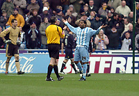 Photo: Leigh Quinnell.<br /> Coventry City v Leeds United. Coca Cola Championship. 18/03/2006. Coventrys Andy Impey asks referee C.Oliver what the penalty is given for.