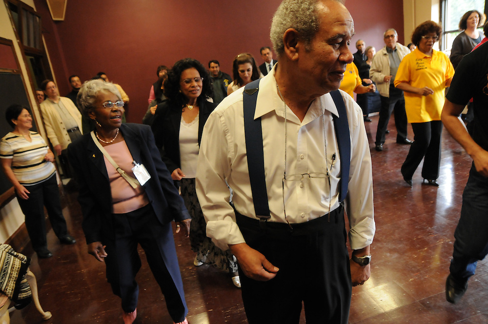 St. Eulalia Catholic Church parishioners, including Joe and Irma Johnson,  help to christen the Cesar Chavez Performing Arts Studio with a line dance during an open house of the newly-inaugurated Quinn Community Center in Maywood. The former home of the parish school had been underutilized for several years until Pastor Carmelo Mendez initiated a revitilization of the building, re-naming it in honor of former St. Eulalia Pastor William Quinn. Quinn made a lasting history for himself as a pioneer for social justice, both in the fields of civil rights, along with those of immigrants.