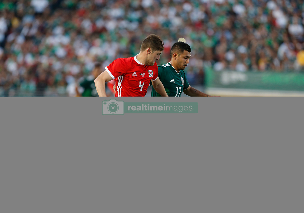 "May 28, 2018 - Pasadena, CA, U.S. - PASADENA, CA - MAY 28: JesÅ""s Mauel Corona of Mexico dribbles past Ben Davies of Wales during the game on May 28, 2018, at the Rose Bowl in Pasadena, CA.  (Photo by Adam  Davis/Icon Sportswire) (Credit Image: © Adam Davis/Icon SMI via ZUMA Press)"