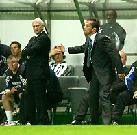 Photo. Jed Wee<br /> Newcastle United v Partizan Belgrade, European Champions League Qualifier, St. James' Park, Newcastle. 27/08/2003.<br /> Partizan manager Lother Matthaeus (R) urges his players on as Newcastle counterpart Sir Bobby Robson looks on.