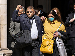 © Licensed to London News Pictures. 23/04/2021. London, UK. Former Post Office sub-postmaster Seema Misra walks with her husband Davinder from The High Court. The Appeal Court has cleared the names of a group of 42 sub-postmasters - some of whom were jailed for stealing money after the Horizon accounting software was installed at Post Offices. At a previous High Court hearing a judge found the Fujitsu accounting system had major faults and defects. The Post Office has already agreed to pay £58m in a settlement with more than 500 sub-postmasters. <br /> Six convictions were overturned last year . Photo credit: Peter Macdiarmid/LNP