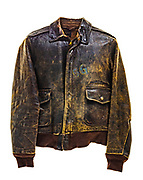 "This is a type A-2 flight jacket. This flight jacket would have been worn by a member of the 390th Bomb Group. This particular jacket does not have any art work on the back, squadron insignia on the front, or name plate to identify whose jacket it was, what squadron they were attached to, or which aircraft they flew. The letters ""SG"" are painted in blue and yellow on the front of the jacket but are heavily faded."