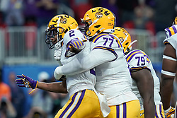 Justin Jefferson celebrates a touchdown during the first half against the Oklahoma Sooners in the 2019 College Football Playoff Semifinal at the Chick-fil-A Peach Bowl on Saturday, Dec. 28, in Atlanta. (Jason Parkhurst via Abell Images for the Chick-fil-A Peach Bowl)