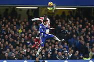 Mame Biram Diouf of Stoke City and Marco Alonso of Chelsea compete for the ball. Premier league match, Chelsea v Stoke city at Stamford Bridge in London on Saturday 31st December 2016.<br /> pic by John Patrick Fletcher, Andrew Orchard sports photography.