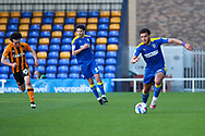 AFC Wimbledon defender Nesta Guinness-Walker (18) dribbling down wing during the EFL Sky Bet League 1 match between AFC Wimbledon and Hull City at Plough Lane, London, United Kingdom on 27 February 2021.