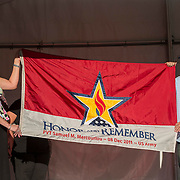August 16, 2014, New Haven, CT:<br /> The Honor and Remember flag is presented to the parents of Pvt. Sam Mercouriou of Suffield, Connecticut during Military Night on day four of the 2014 Connecticut Open at the Yale University Tennis Center in New Haven, Connecticut Monday, August 18, 2014. Pvt. Mercouriou, age 18, died on December 8, 2011 at Fort Benning, Georgia. <br /> (Photo by Billie Weiss/Connecticut Open)