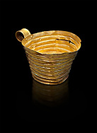 Mycenaean gold cup with horizontal grroves, Grave IV, Grave Circle A, Mycenae, Greece. National Archaeological Museum of Athens. An elegant precious gold cup hammered from thick gold to created a simple elegant design. This Mycenaean gold cup demonstrates how advance Mycenaean metalworking was in the 16th century BC. The value of the cup would have been extermely high so must have graced the table of a Mycenaean noble perhaps even a v king. .<br /> <br /> If you prefer to buy from our ALAMY PHOTO LIBRARY  Collection visit : https://www.alamy.com/portfolio/paul-williams-funkystock/mycenaean-art-artefacts.html . Type -   Athens    - into the LOWER SEARCH WITHIN GALLERY box. Refine search by adding background colour, place, museum etc<br /> <br /> Visit our MYCENAEN ART PHOTO COLLECTIONS for more photos to download  as wall art prints https://funkystock.photoshelter.com/gallery-collection/Pictures-Images-of-Ancient-Mycenaean-Art-Artefacts-Archaeology-Sites/C0000xRC5WLQcbhQ