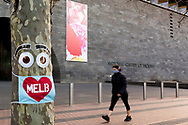 A woman walks past a tree wearing a mask in front of an empty National Gallery of Victoria during COVID-19 in Melbourne, Australia. Hotel quarantine linked to 99% of Victoria's COVID-19 cases, inquiry told. This comes amid a further 222 new cases being discovered along with 17 deaths. Melbourne continues to reel under Stage 4 restrictions with speculation that it will be extended. (Photo by Dave Hewison/Speed Media)