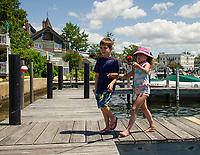 Fishing from the docks at The Windrifter Resort in Wolfeboro Bay.  (Karen Bobotas Photographer)