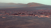 A portion of the west rim of Endeavour crater sweeps southward in this false color view from NASA's Mars Exploration Rover Opportunity.
