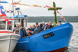 June 24, 2017 - Puck, Poland - Fishing boats are seen during the annual Kashubian fishermen sea pilgrimage in Puck, Poland. Every year fishermen from Kashubia region pay honour to died at the Baltic sea colleagues and pray for  the prosperity of fishing. (Credit Image: © Michal Fludra/NurPhoto via ZUMA Press)