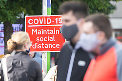 © Licensed to London News Pictures. 09/10/2020. Liverpool, UK. Masked shoppers in Liverpool aren't deterred by bad weather. Pubs and restaurants in the North of England could be forced to close as early as Monday, and vulnerable people told to shield through the winter. Photo credit: Kerry Elsworth/LNP