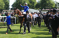 Jockey James Doyle on Barney Roy celebrates in the winners encloser after winning the St James's Palace Stakes as owner Sheikh Mohammed bin Rashid Al Maktoum (right) looks on during day one of Royal Ascot at Ascot Racecourse.