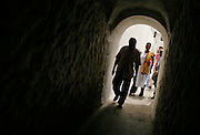 Leader of the House of Lords Baroness Valerie Amos walks into a dark corridor as she visits the former slave fort of Elmina Castle in Elmina, Ghana, on Sunday Mar 4, 2007. Amos was visiting on the occasion of the 200th anniversary of the abolition of slave trade, which coincides with Ghana's 50th anniversary of independence.