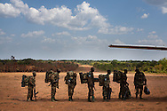 UPDF troops prepare to board a plan in the Central Africa Republic to return home to Uganda for leave. The AU is planning on more than doubling the size of the force looking for LRA leader Joseph Kony to 5000 by bringing in CAR and Congo soliders to fight alongside the Ugandas.