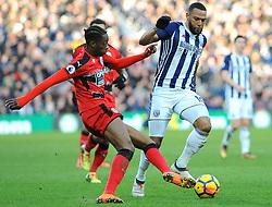 Abdelhamid Sabiri of Huddersfield Town battles with Matt Phillips of West Bromwich Albion- Mandatory by-line: Nizaam Jones/JMP - 24/02/2018 - FOOTBALL - The Hawthorns - West Bromwich, England - West Bromwich Albion v Huddersfield Town- Premier League
