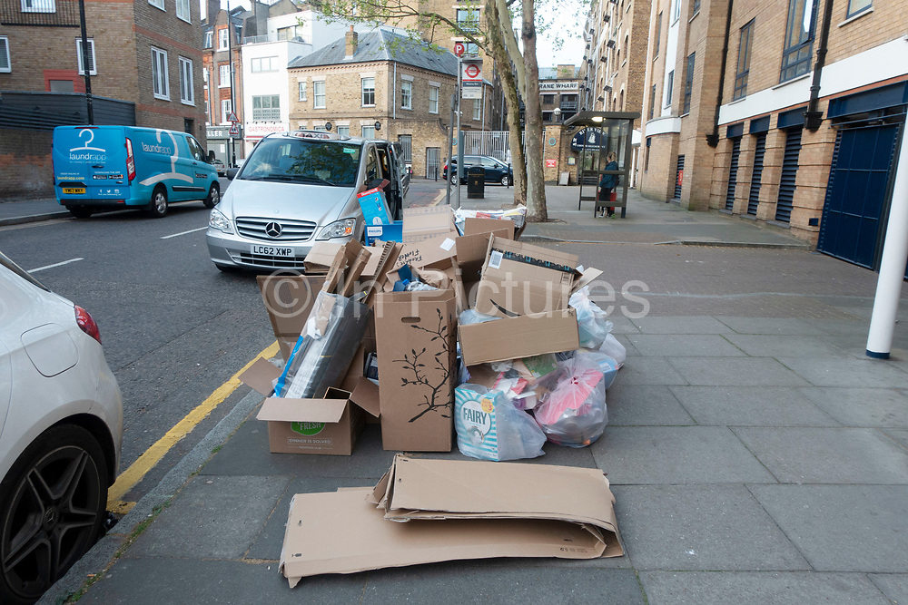Rubbish piled high on the street in Wapping, London, England, United Kingdom.