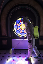 March 17, 2020, Istanbul, Turkey: A medical official in hazmat suit spray disinfectant near a stain glass window at the Sveti Stefan Church at Balat in Istanbul. (Credit Image: © Akin Celiktas/Depo Photos via ZUMA Wire)
