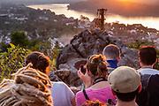 Tourists take sunset photographs from atop Mount Phousi,  Luang Prabang, Laos.