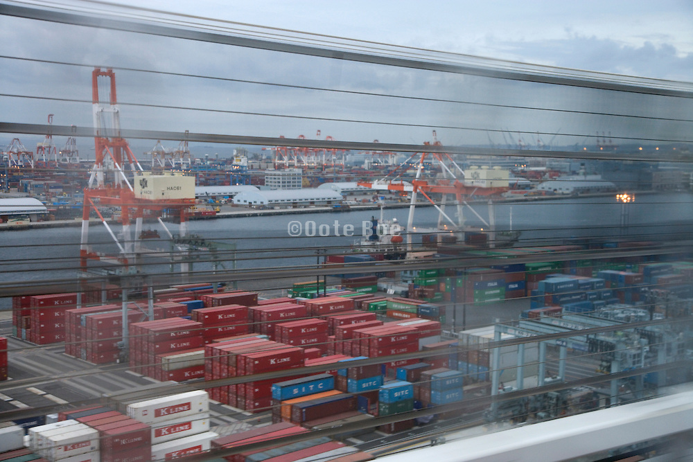 container seaport in Tokyo bay Japan seen from driving car
