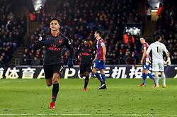 Arsenal's Alexis Sanchez celebrates scoring his side's third goal of the game during the Premier League match at Selhurst Park, London.