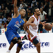 Galatasaray Cafe Crown's Joshua Ian SHIPP (R) and Asefa Estudiantes's Tyrone ELLIS (L) during their ULEB Eurocup Quarterfinals last 16 group K game 2 basketball match Galatasaray between Asefa Estudiantes at the Abdi Ipekci Arena in Istanbul at Turkey on Tuesday, January, 25, 2011. Photo by TURKPIX