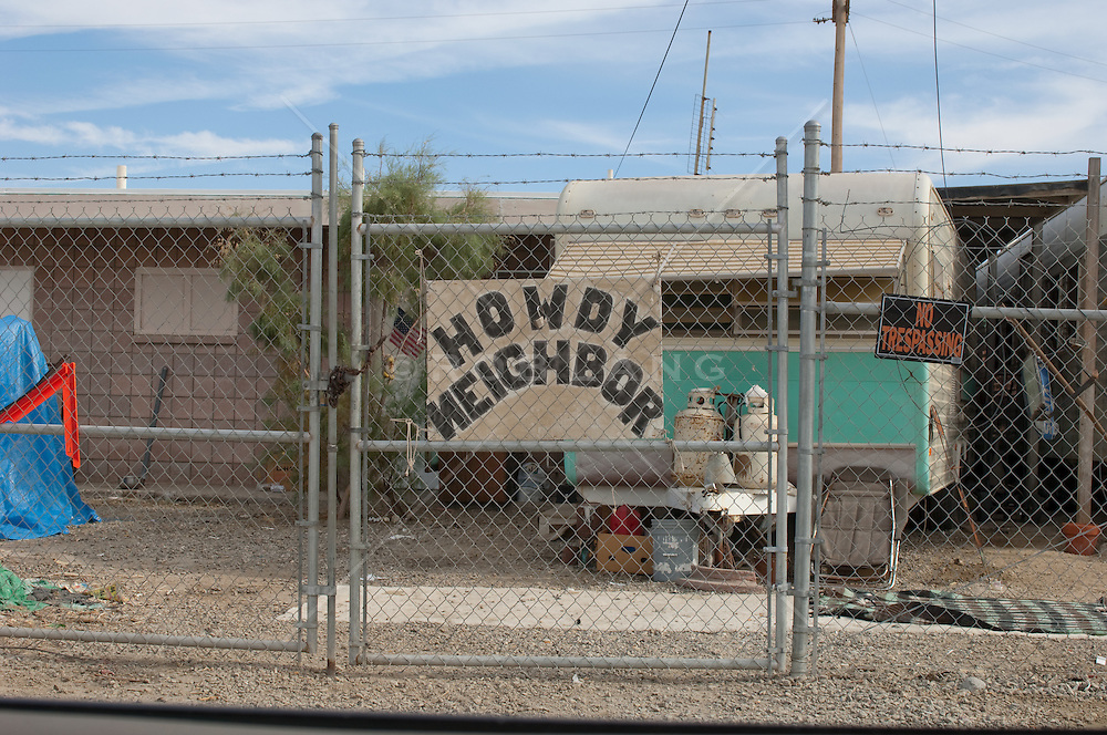 Gated camper with warning signs