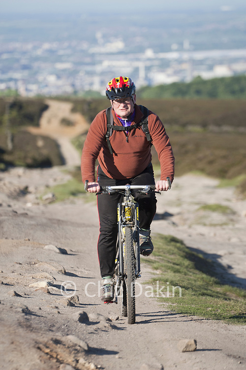 Andy cycling up Houndkirk Road - a fantastic off-road track between Ringinglow and Fox House, Peak District National Park