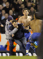 Photo: Olly Greenwood.<br />Tottenham Hotspur v Chelsea. The FA Cup, Quarter Final replay. 19/03/2007. A Spurs fan runs onto the pitch and attempts to hit Chelsea's Frank Lampard but is stopped by Didier Drogba and the security guards
