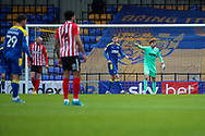 AFC Wimbledon goalkeeper Sam Walker (1) pointing and shouting during the EFL Sky Bet League 1 match between AFC Wimbledon and Sunderland at Plough Lane, London, United Kingdom on 16 January 2021.