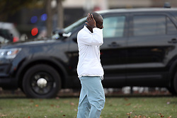 November 19, 2018 - Chicago, Illinois, U.S. - Hospital worker outside Mercy hospital after the shooting. Police officers close off an area near Mercy Hospital on Chicago's Near South Side, where there was an active shooter situation and multiple people were reported shot. Emergency crews were called to the hospital, 2525 S. Michigan Ave., about 3:20 p.m. (Credit Image: © Erin Hooley/Chicago Tribune/TNS via ZUMA Wire)