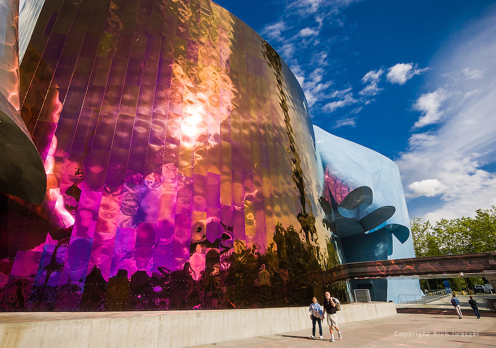 Visitors walk past the exterior of Experience Music Project, at Seattle Center, Seattle, Washington