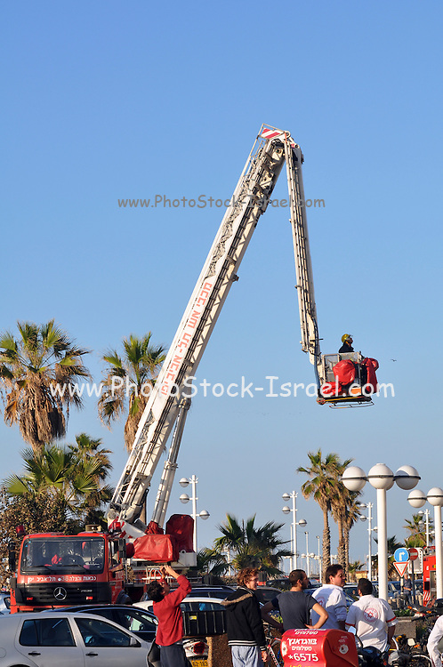 Israel Tel Aviv, The new modern residential and commercial Opera tower built over the remains of the old Opera house in Allenby Street on the beach front. A fire broke out in an apartment November 11 2009. Rescue crane in operation