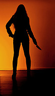 Silhouette of a woman holding a knife