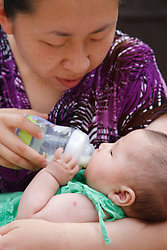 Chinese mother feeding baby