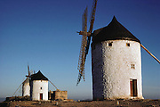 Whitewashed windmills in Consuegra, Spain.  Consuegra, La Mancha, Spain.