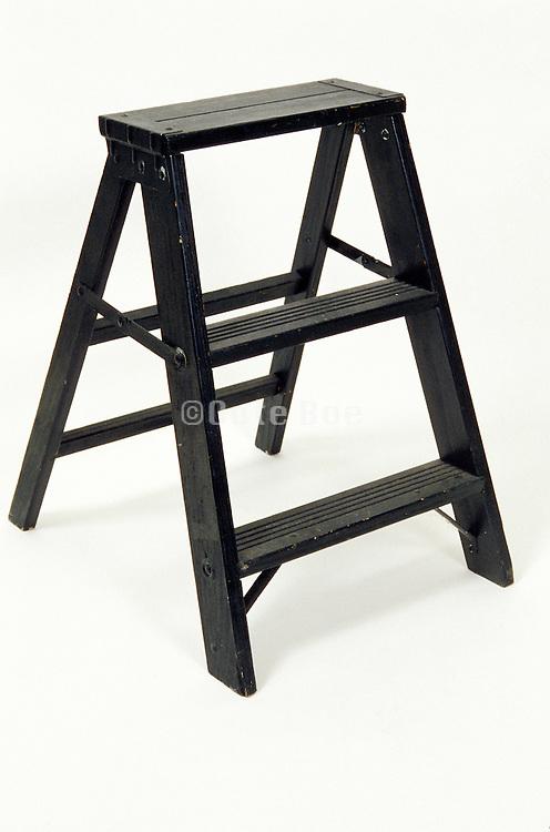 still life of black step ladder