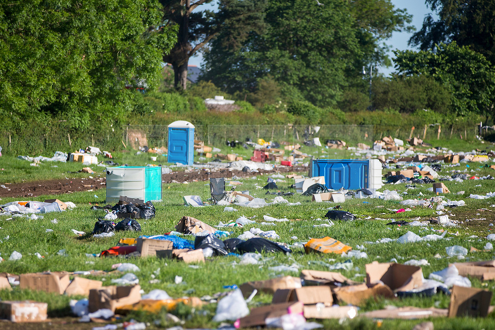 © Licensed to London News Pictures. 10/06/2019. Appleby UK. Overturned Portaloo lay among the rubbish left in fields this morning by Travellers leaving the Appleby Horse Fair in Cumbria. Appleby Horse Fair attracts around 10,000 Gypsies & Travellers & is thought to be the largest Gypsy Fair in Europe. Photo credit: Andrew McCaren/LNP