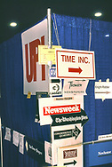 SIGNS OF THE TIMES.  Signs pointing to the offices of magazines and news services in the media work area at the Democratic Convention in July 1988.<br /> Photograph ny Dennis Brack. bb78