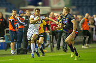 Robert Baloucoune(#14) of Ulster Rugby runs past Duhan van der Merwe (#11) of Edinburgh Rugby during the Guinness Pro 14 2018_19 match between Edinburgh Rugby and Ulster Rugby at the BT Murrayfield Stadium, Edinburgh, Scotland on 12 April 2019.