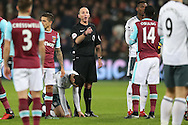 Referee Mike Dean waves his finger at Pedro Mba Obiang of West Ham United (14). Premier league match, West Ham Utd v Manchester Utd at the London Stadium, Queen Elizabeth Olympic Park in London on Monday 2nd January 2017.<br /> pic by John Patrick Fletcher, Andrew Orchard sports photography.