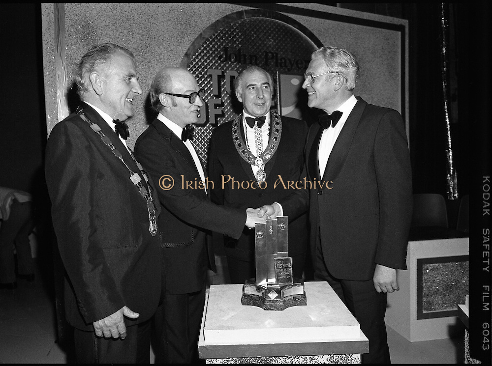 "Tops of the Town Final.   (N79)..1981..31.05.1981..05.31.1981..31st May 1981..The John Player sponsored Tops Of The Town competition had its final tonight in the Gaiety Theatre, Dublin.The overall winners were the Limerick Insurances Group...Photograph shows Mr Raymond Kirk, producer of St Joseph's Youth Club, Strabane show which was runner up in the ""Tops"" final receiving his award from Mr Oliver Casey, Managing Director, John Player. Included in the photograph are Clr Clem Casey, Lord Mayor of Limerick and Clr Edward Turner,Chairman, Strabane District Council."