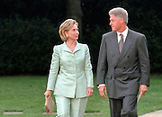 US President Bill Clinton with first lady Hillary Clinton walk across the South Lawn of the White House lawn September 10, 1998 in Washington, DC. The Clintons were leaving to attend a Democratic Party event on the day the Starr Report was delivered to Congress.