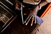The hands of Mr Dembo, tailor in Bijene. Tailor is very popular craft among men in Guinea Bissau.